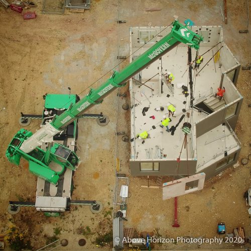 Construction Site Crane and Concrete BuildingAssembly